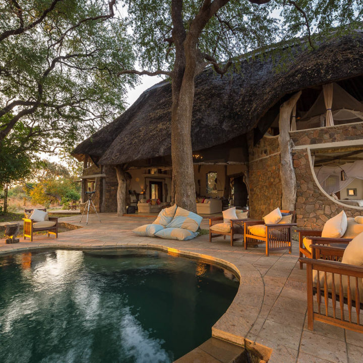 premium-family-adventure-zambia-in-style-safari-packages-tours-luxury-luangwa-safari-house-south-luangwa-pool-day