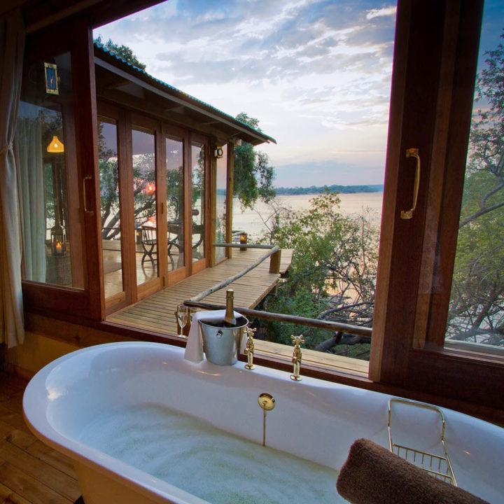 premium-family-adventure-zambia-in-style-safari-packages-tours-luxury-tongabezi-dog-house-bath-view