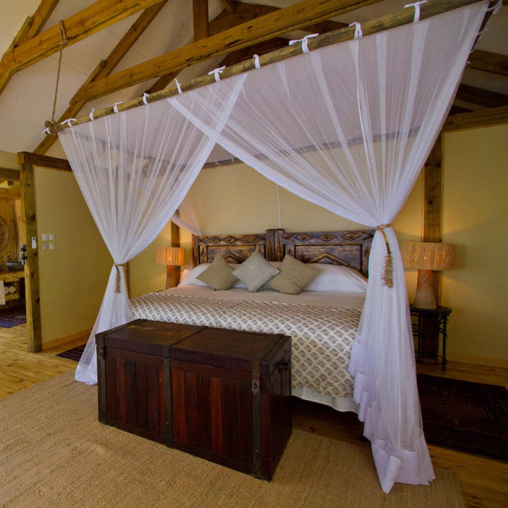 premium-family-adventure-zambia-in-style-safari-packages-tours-luxury-tongabezi-dog-house-bed