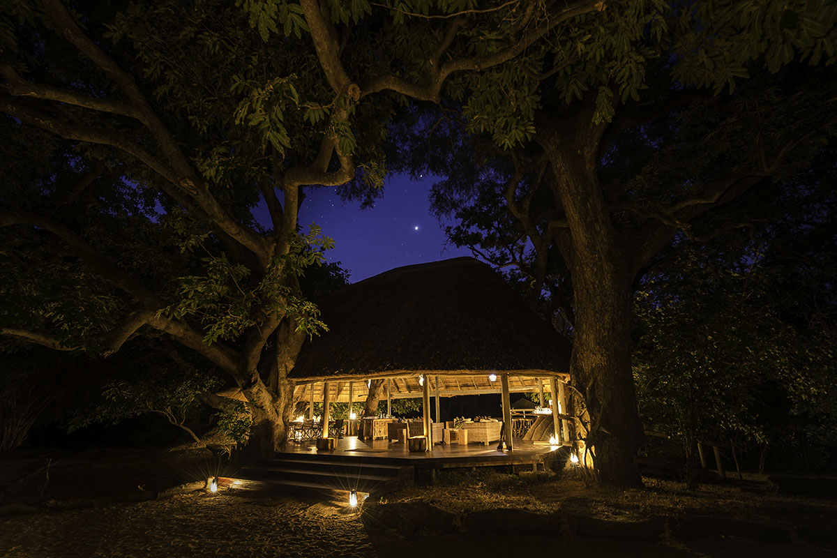 bilimungwe bush camp lodge-zambia-in-style-tours-safari-packages-lodges-south-luangwa-national-park-africa-lodge-trees-night-sky