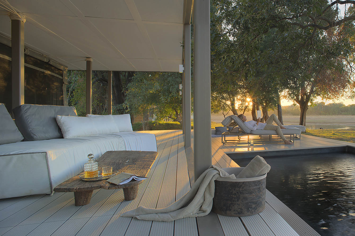 chinzombo-glamourous-lodge-zambia-in-style-tours-safari-packages-lodges-exploring-south-luangwa-national-park-lounge-area-deck