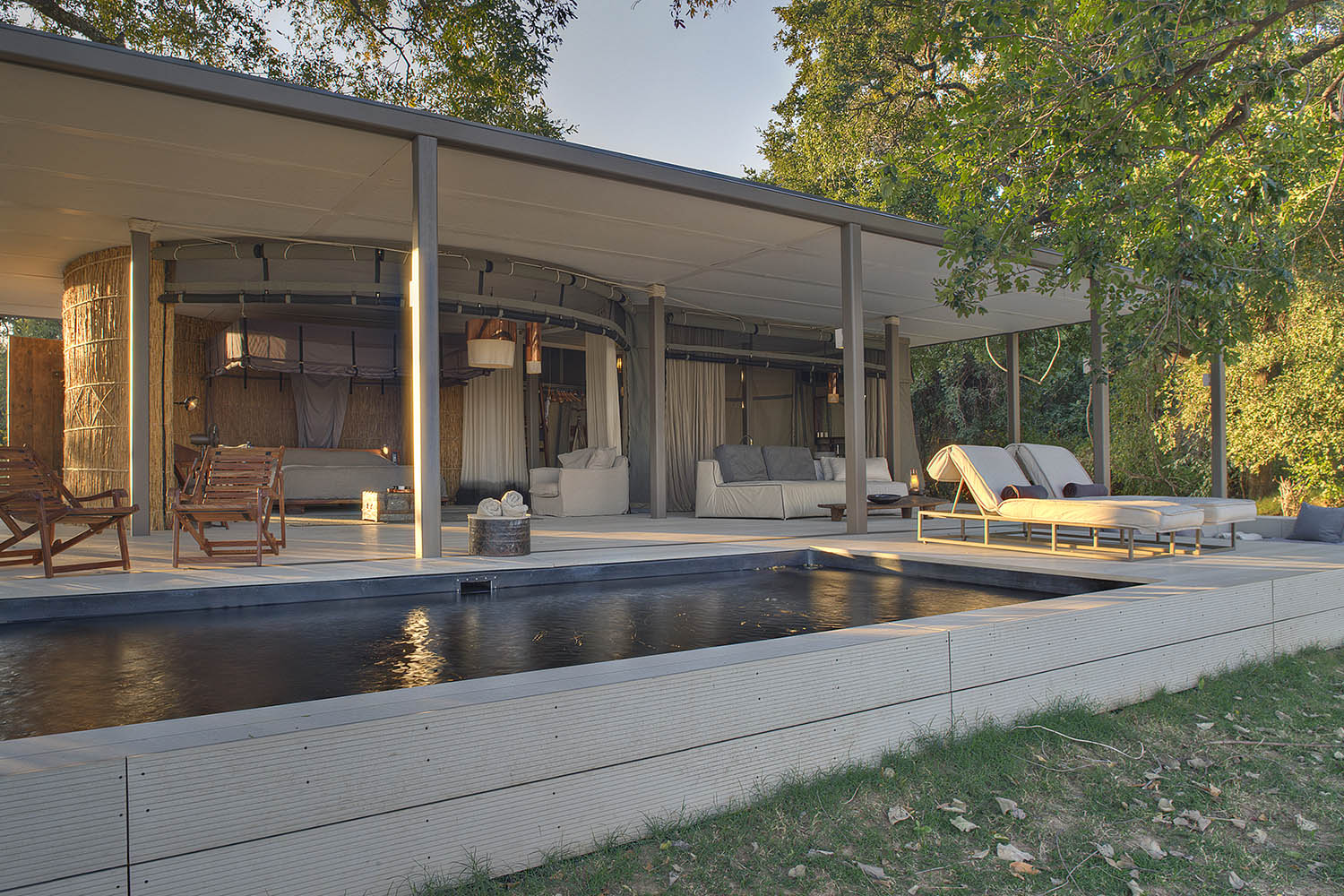 chinzombo-glamourous-lodge-zambia-in-style-tours-safari-packages-lodges-exploring-south-luangwa-national-park-pool-deck-exterior