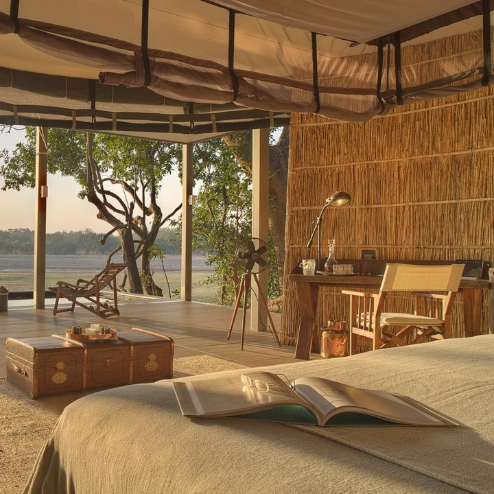 chinzombo-glamourous-lodge-zambia-in-style-tours-safari-packages-lodges-exploring-south-luangwa-national-park-villa-bed