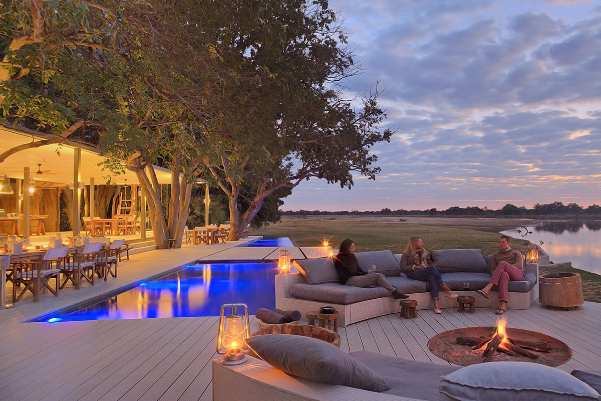 chinzombo-zambia-in-style-tours-safari-packages-lodges-travel-south-luangwa-national-park-fireplace-lounge-area