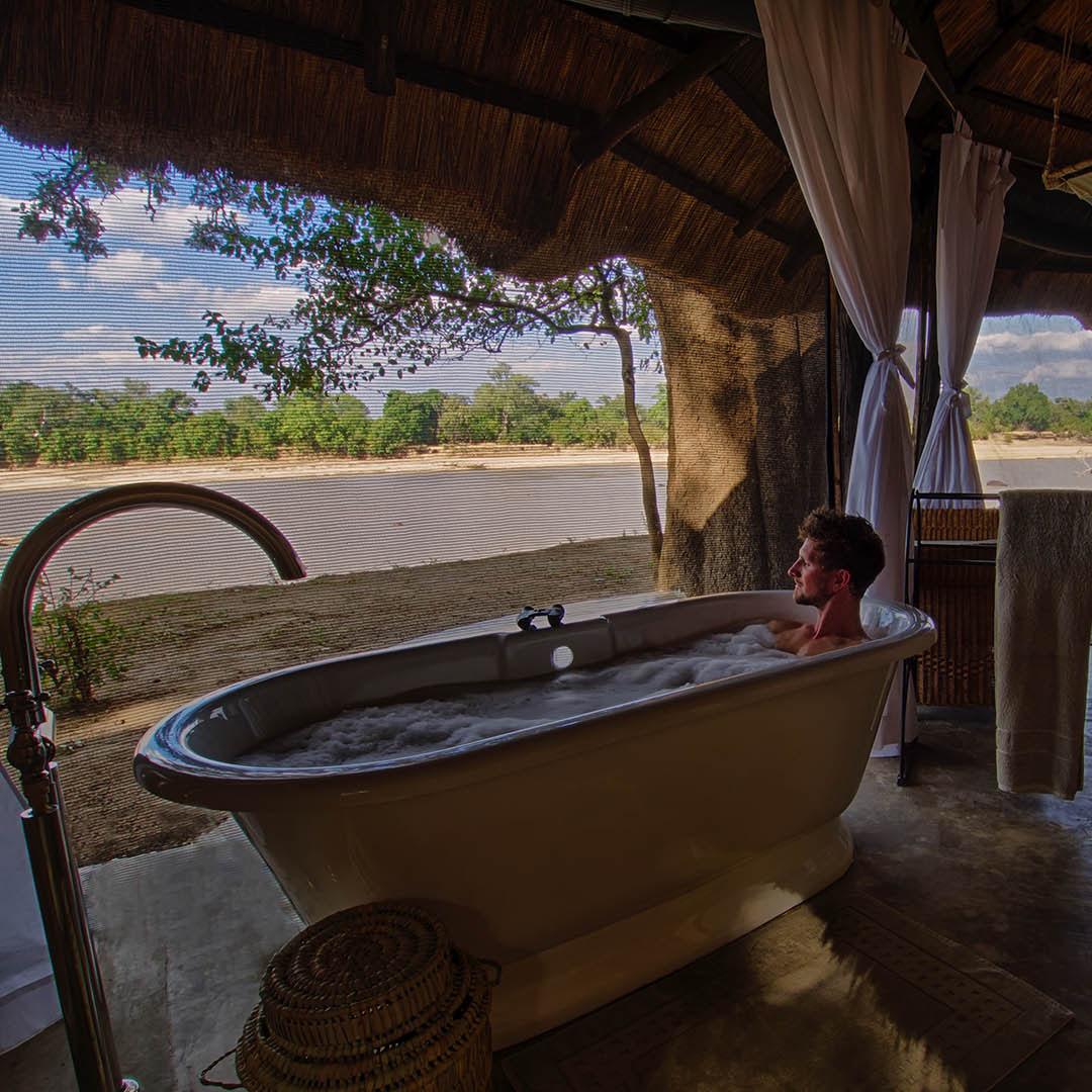 mchenja-bush-camp-lodge-zambia-in-style-tours-safari-packages-lodges-explore-south-luangwa-national-park-bathtub-view