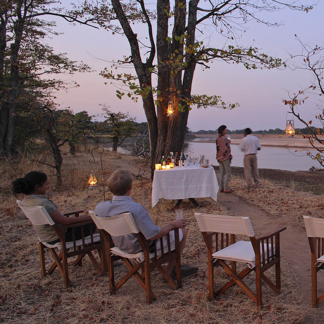 mchenja-bush-camp-lodge-zambia-in-style-tours-safari-packages-lodges-explore-south-luangwa-national-park-river-drinks-views