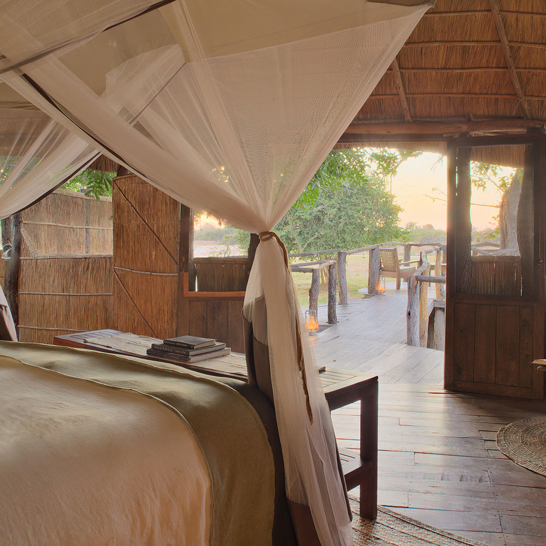 nsolo-lodge-zambia-in-style-tours-safari-packages-lodges-south-luangwa-national-park-bed-view