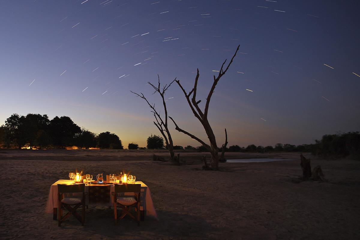 nsolo-lodge-zambia-in-style-tours-safari-packages-lodges-travel-south-luangwa-national-park-dining-under-the-stars