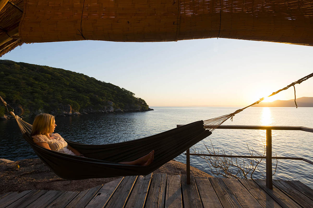 tafika-camp-lodge-malawi-classic-adventure-tour-zambia-in-style-safari-packages-Mumbo-Island-Lake-Malawi-hammock-sunset