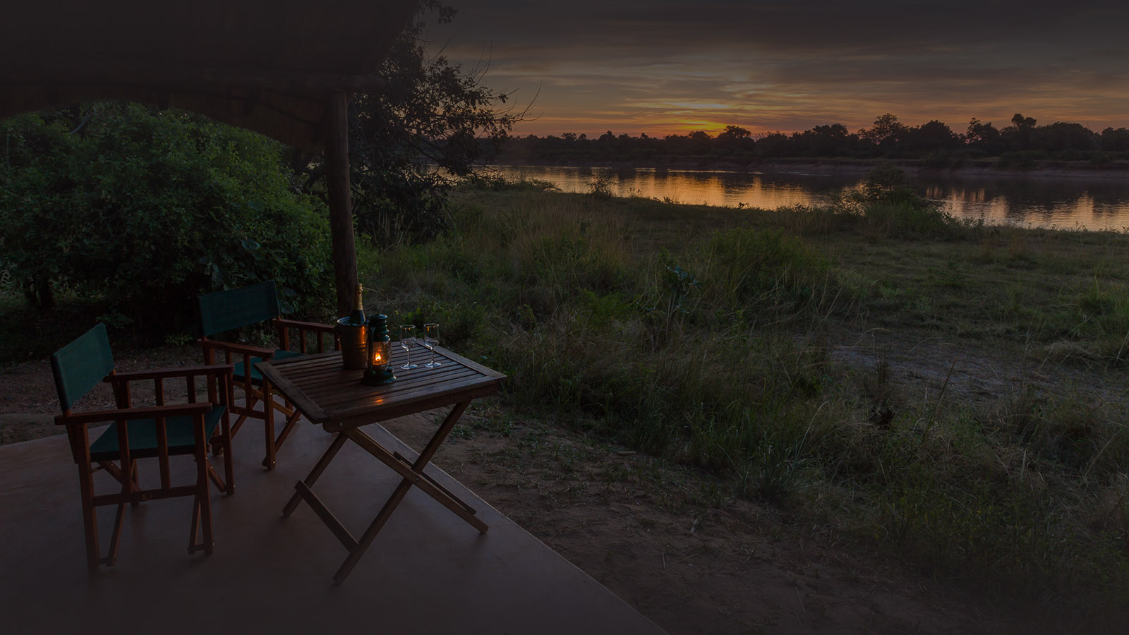 flatdogs-camp-zambia-in-style-tours-safari-packages-lodges-explore-south-luangwa-national-park-luxury-tent-view-sunset-drinks