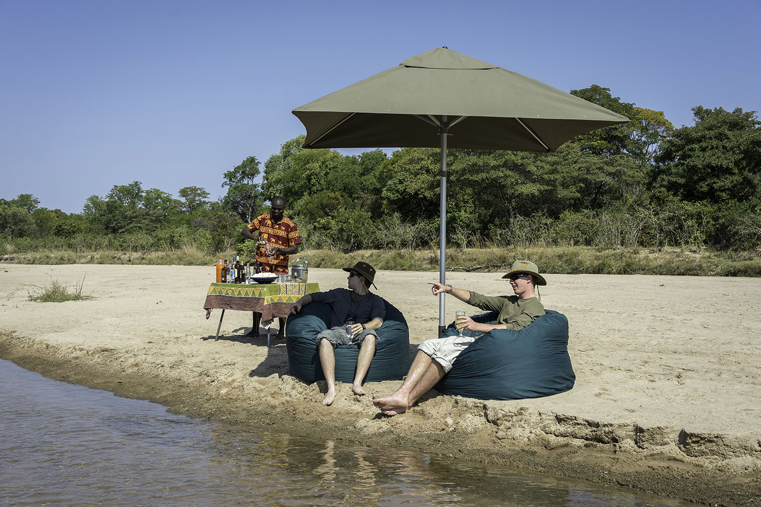 kapamba bushcamp lodge-zambia-in-style-safari-packages-lodges-south-luangwa-national-park-relaxing-on-river-drinks