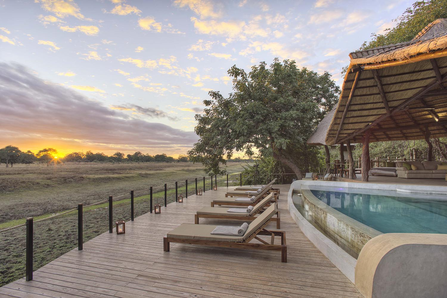 lion camp lodge zambia-in-style-safari-packages-tours-south-luangwa-national-park-main-deck-pool