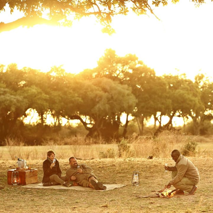 lion camp lodge-zambia-in-style-safari-packages-tours-south-luangwa-national-park-sundowner-guest-experience-romance