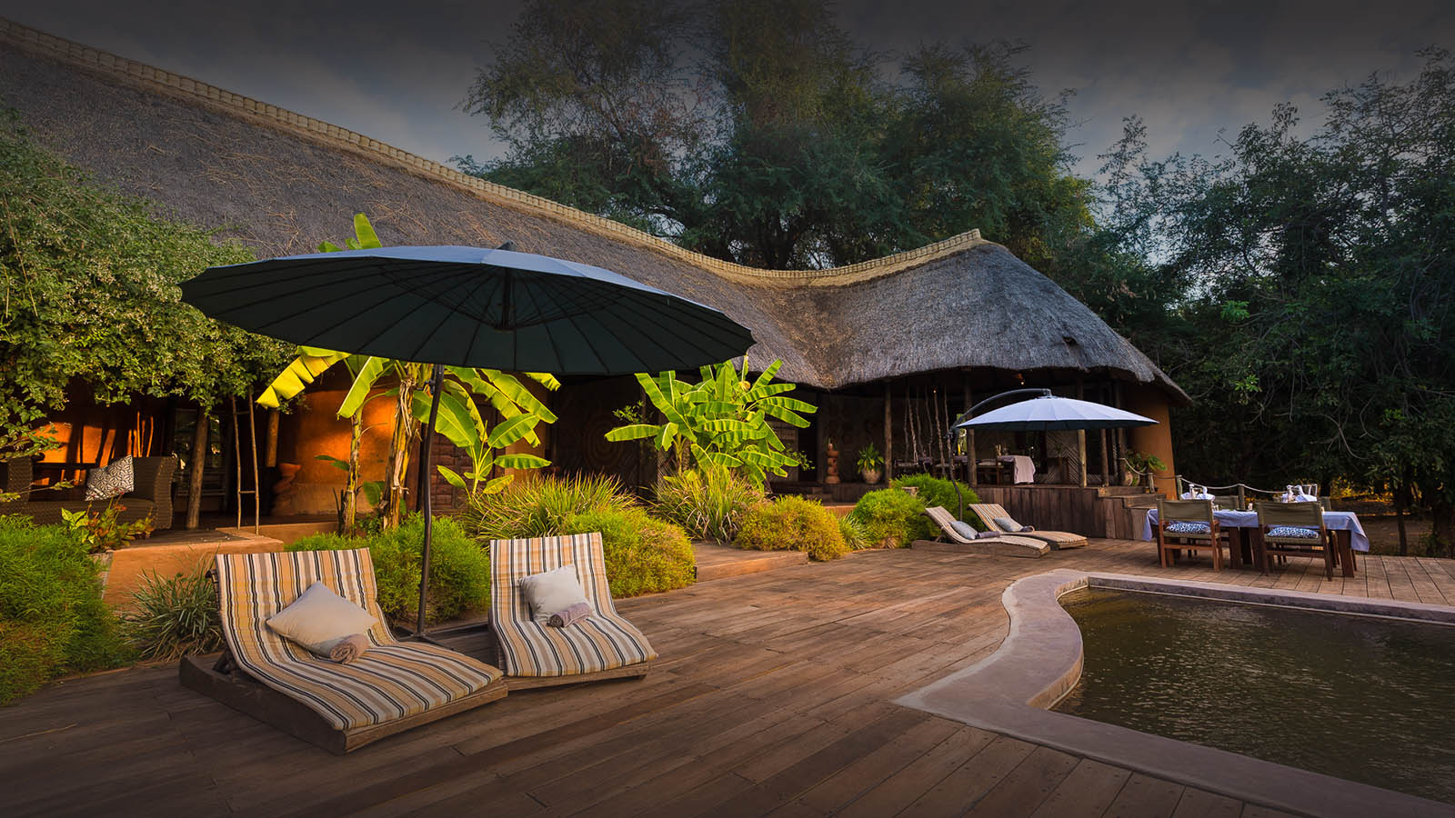 luangwa river camp lodge-zambia-in-style-safari-packages-south-luangwa-national-park-tours-chairs-deck-pool-area