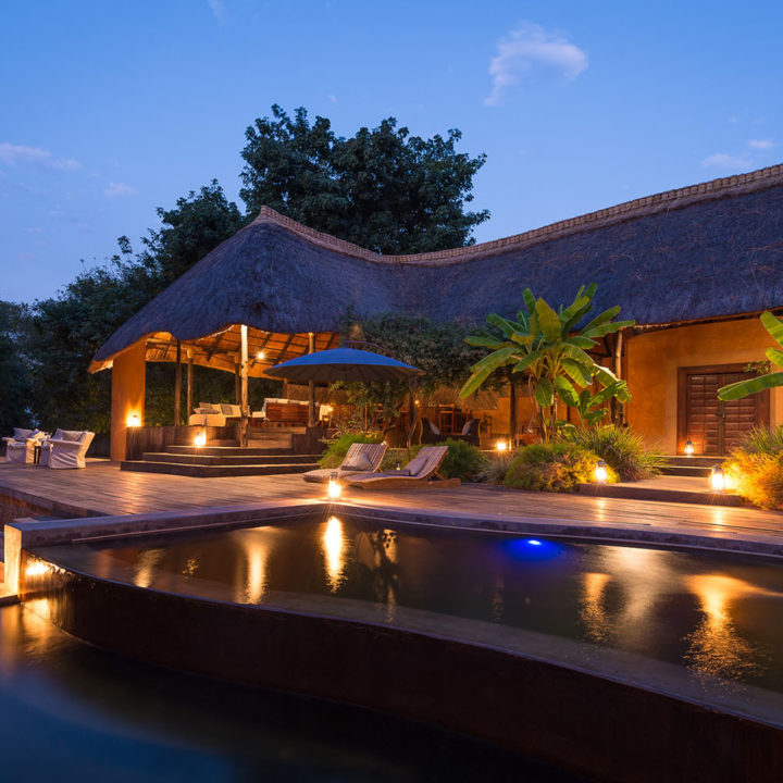 luangwa river camp lodge-zambia-in-style-safari-packages-south-luangwa-national-park-tours-pool-evening