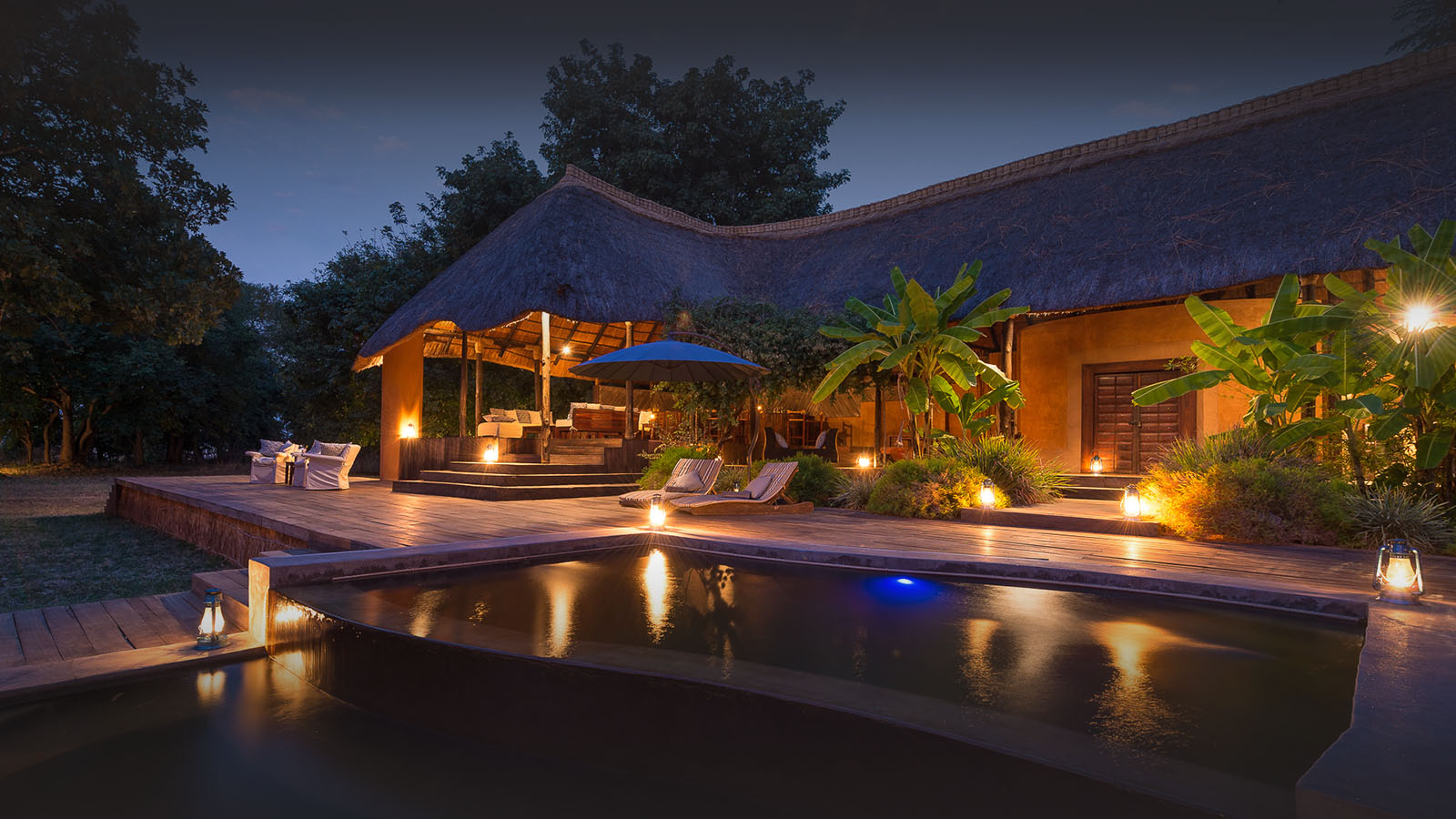 luangwa river camp lodge-zambia-in-style-safari-packages-south-luangwa-national-park-tours-pool-night
