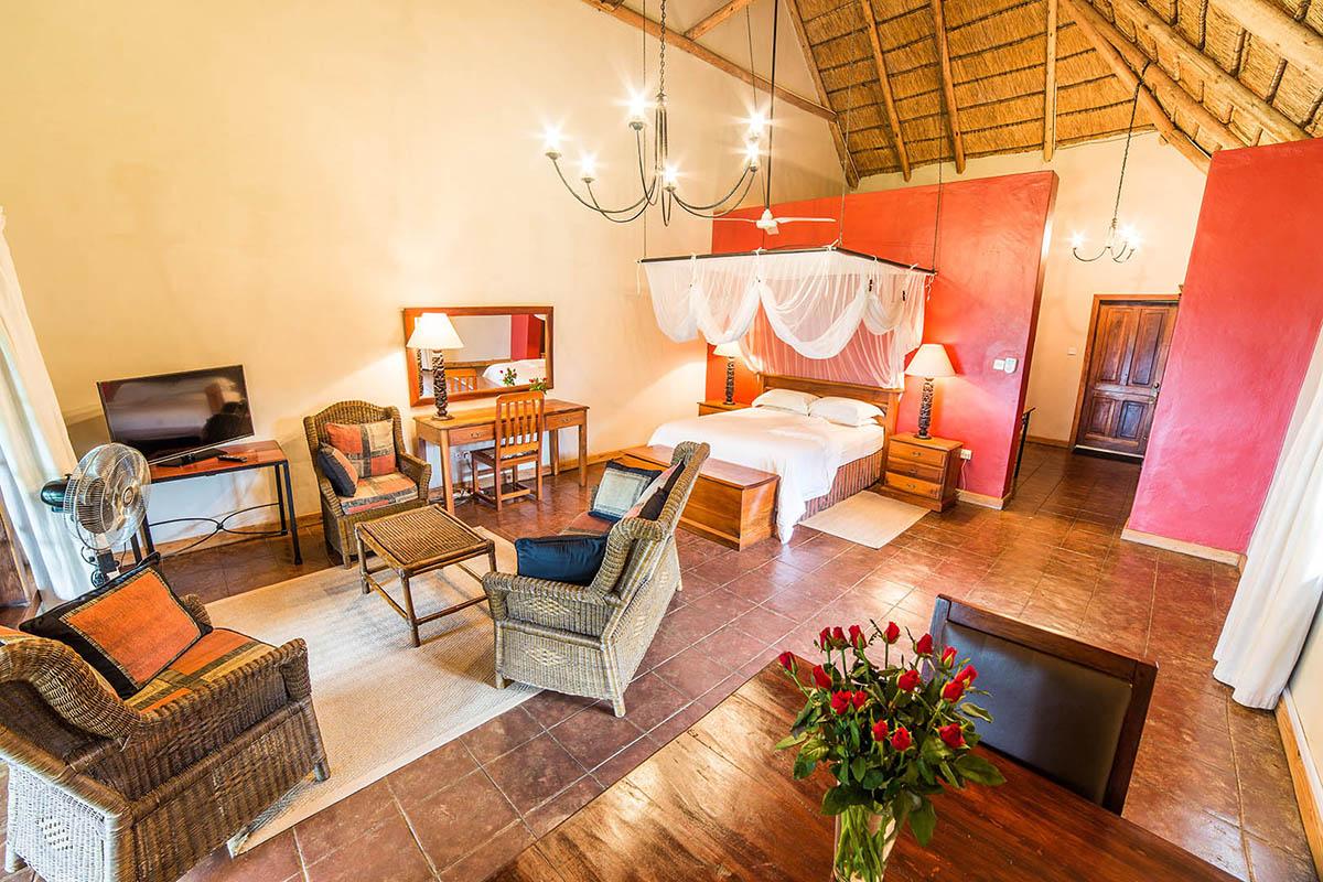 nkonzi-camp-lodge-discover-zambia-malawi-glamping-wild-tour-zambia-in-style-safari-packages-Kumbali-Lodge-Lilongwe-bed-tables