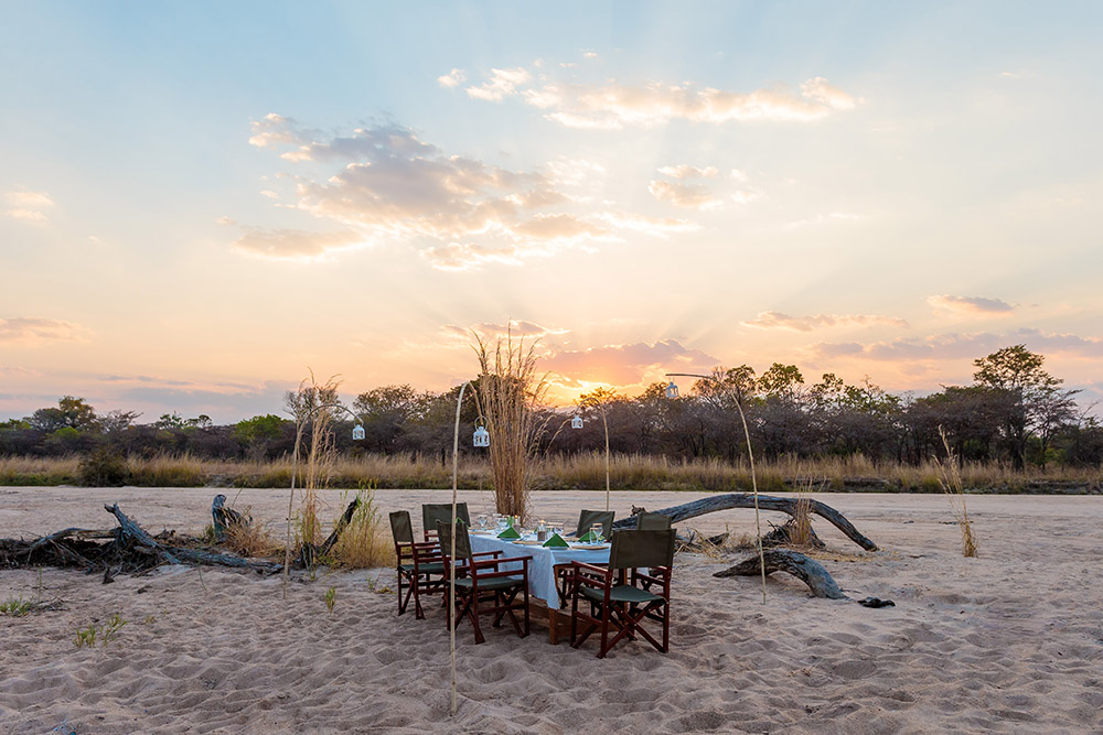 nkonzi-camp-lodge-zambia-in-style-safari-packages-lodges-exploring-south-luangwa-national-park-table-set-Milky-Way-dinner