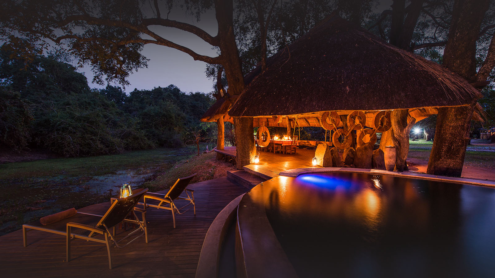 nkwali-zambia-in-style-safari-packages-south-luangwa-national-park-pool-night