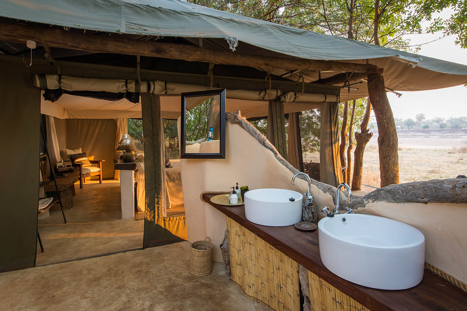 tena tena camp lodge-zambia-in-style-safari-packages-lodges-south-luangwa-national-park-bathroom-outside