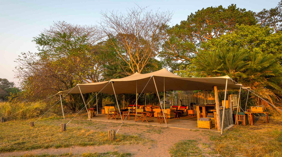 busanga bush camp zambia-in-style-safari-packages-lodges-kafue-national-park-canvas-chalets-camp-fire