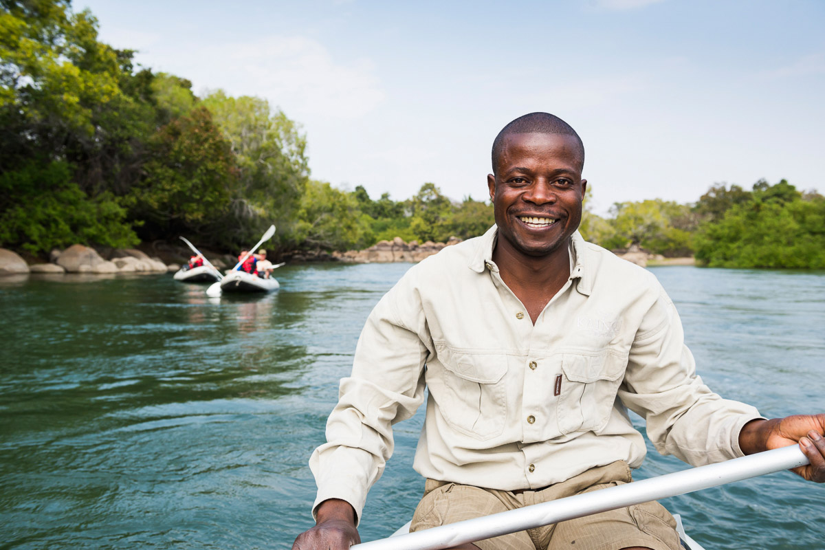kaingu safari lodge zambia-in-style-safari-packages-lodges-explore-kafue-national-park-guide-smiling-river-canoe