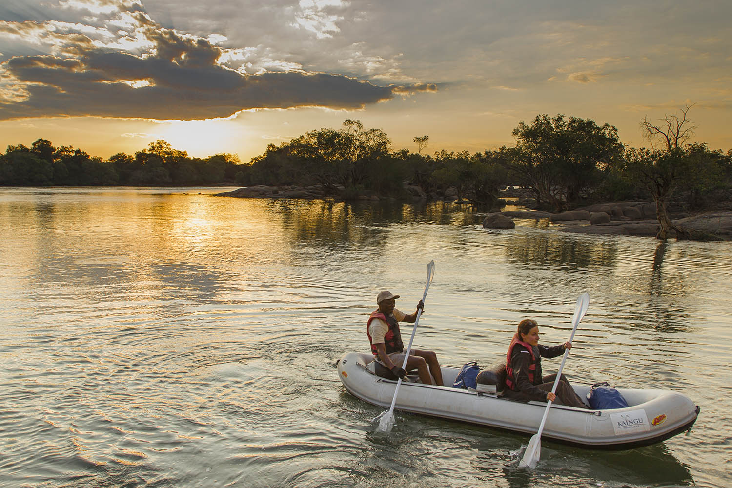 kaingu safari lodge zambia-in-style-safari-packages-lodges-exploring-kafue-national-park-sunset-sky-river-canoe-trails