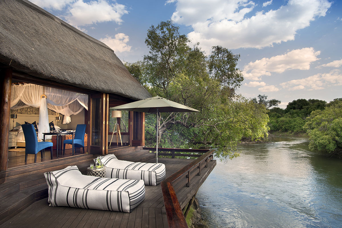 the royal chundu zambia-in-style-safari-packages-lodges-livingstone-zambezi-river-banks-island-suite-deck