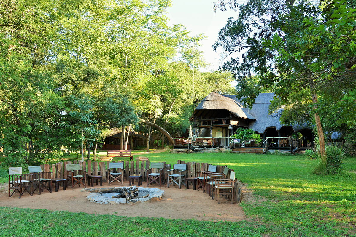 ivory lodge zimbabwe-lodges-zambia-in-style-tours-safari-packages-safaris-wildlife-africa-sikumi-forest-reserve-camp-fire