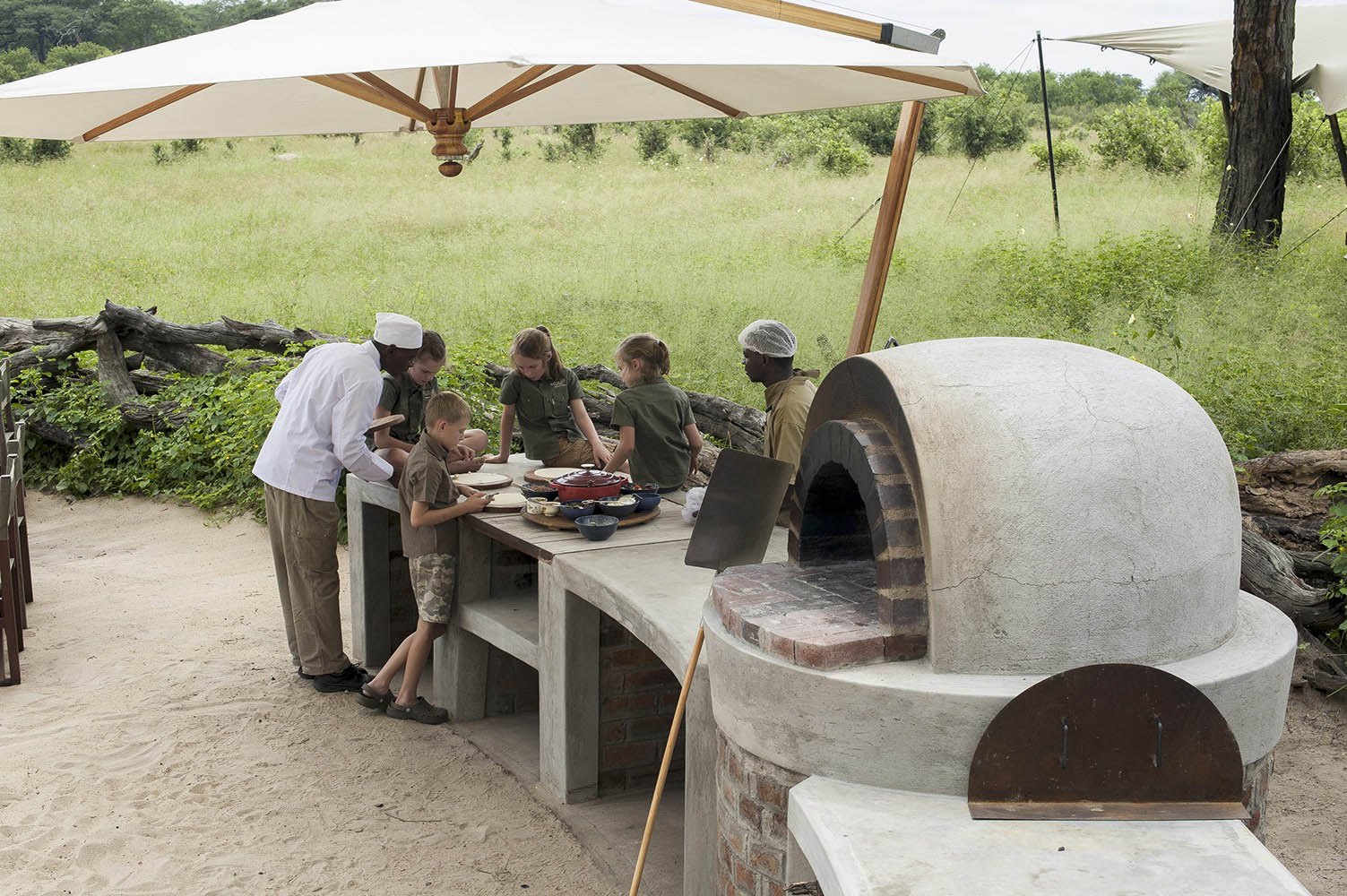 somalisa acacia zimbabwe-lodges-zambia-in-style-safaris-wildlife-africa-hwange-national-park-friendly-staff-chef-cooking