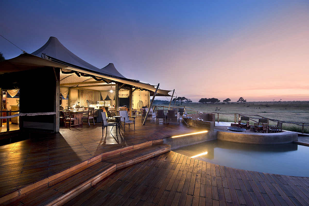 somalisa camp zimbabwe-lodges-zambia-in-style-tours-safari-packages-safaris-wildlife-africa-african-bush-camps-pool-evening-sky