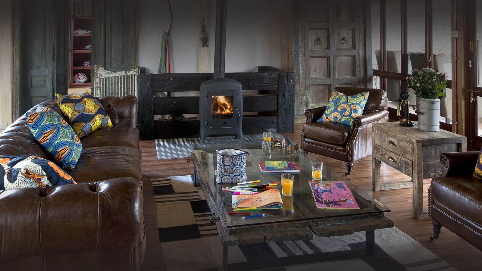 khayelitshe house matobo-hills-national-park-zimbabwe-lodges-living-room-fireplace