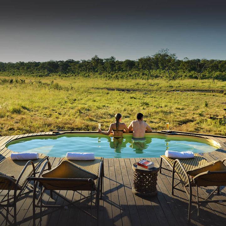 khulu bush camp zimbabwe-lodges-zambia-in-style-safaris-wildlife-africa-hwange-national-park-swimming-pool-deck