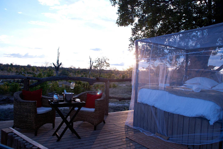 elephants eye eco lodge hwange-national-park-zimbabwe-lodges-the-eye-sleepout-deck-bed-drinks