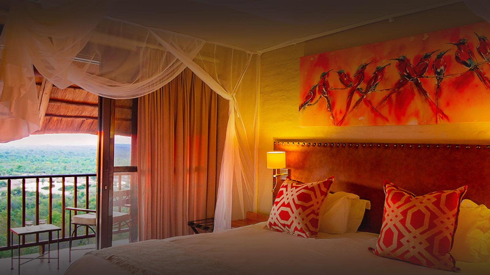 victoria falls safari lodge zimbabwe-lodges-accommodation-vic-falls-bedroom-facing-waterhole