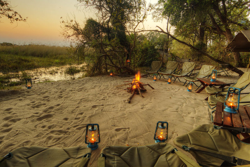 footsteps camp okavango-delta-botswana-lodges-zambia-in-style-walking-safaris-intimate-camp-fire-sunset