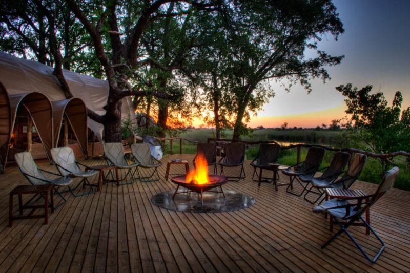okuti camp moremi-game-reserve-botswana-lodges-zambia-in-style-unique-mosasas-unique-safari-tents-camp-fire