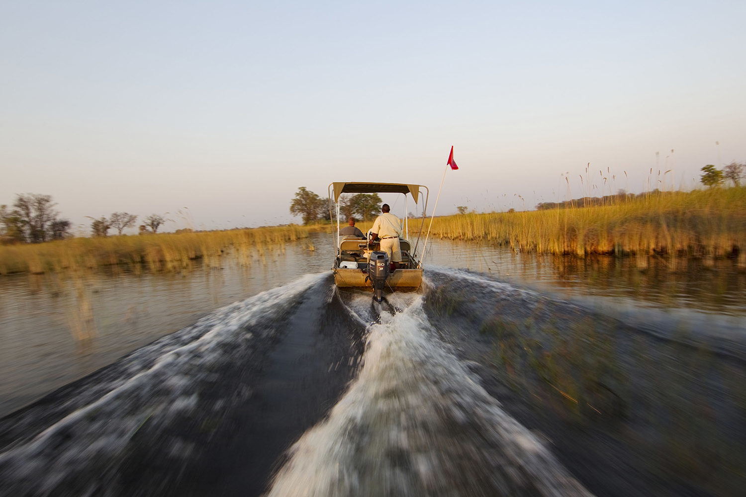 okuti camp moremi-game-reserve-botswana-lodges-zambia-in-style-unique-wilderness-boat-spray-river