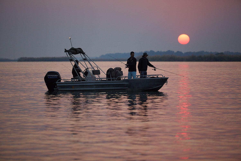 zambezi grande zambia-in-style-lower-zambezi-national-park-modern-lodge-activities-fishing-at-sunset