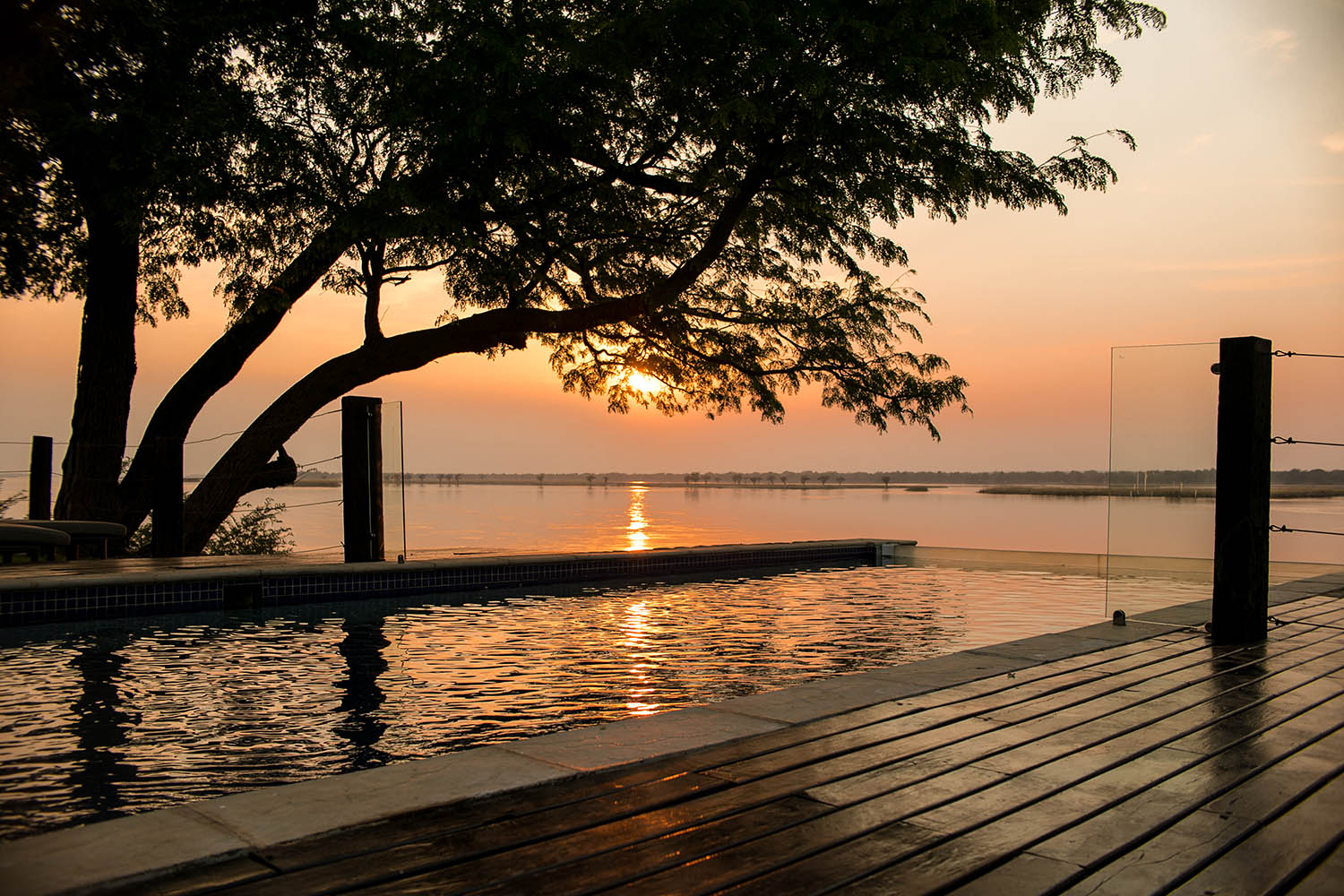 zambezi grande zambia-in-style-lower-zambezi-national-park-modern-lodge-pool-at-sunset
