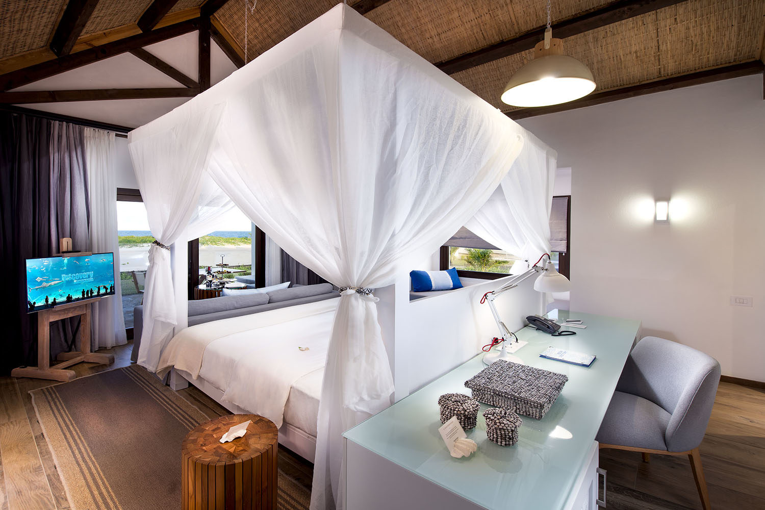 diamonds mequfi beach resort mozambique-lodges-pemba-zambia-in-style-untouched-paradise-bungalows-bed