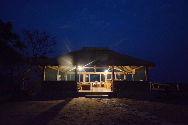 kasonso busanga camp kafue-lodges-zambia-in-style-busanga-plain-kafue-national-park-rustic-luxury-unique-location-exclusive-camp-boma-at-night