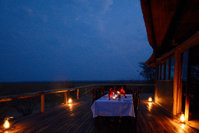 kasonso busanga camp kafue-lodges-zambia-in-style-busanga-plain-kafue-national-park-rustic-luxury-unique-location-exclusive-camp-deck-dining-at-night
